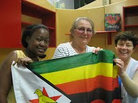Dorcas and Joan, the Zimbabwean community with flag and Christine Coles,   Palmerston North facilitator