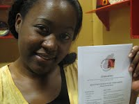 Dorcas Shumba holding her mother's favourite recipe (Dorcas rang her mother in Zimbabwe to check she remembered it correctly!)