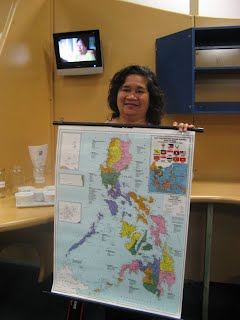 Meriam Findlay, Filipino coordinator with Philippines map - over 7000 islands in the country!